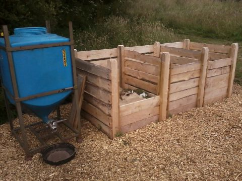 Three wooden compost bins