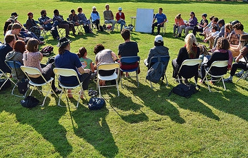 Learning together in a group circle at the international permaculture convergence, uk 2015
