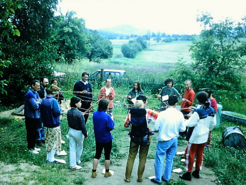 Group of people in a field discussing disaster planning